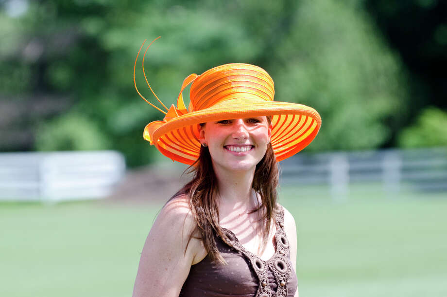 April Schrek, of Greenwich, smiles during the first annual Virginia House of Hope charity polo match fundraiser at the Greenwich Polo Club at Conyers Farm on Hurlingham Drive in Greenwich on Sunday, July 14, 2013. Photo: Amy Mortensen / Connecticut Post Freelance