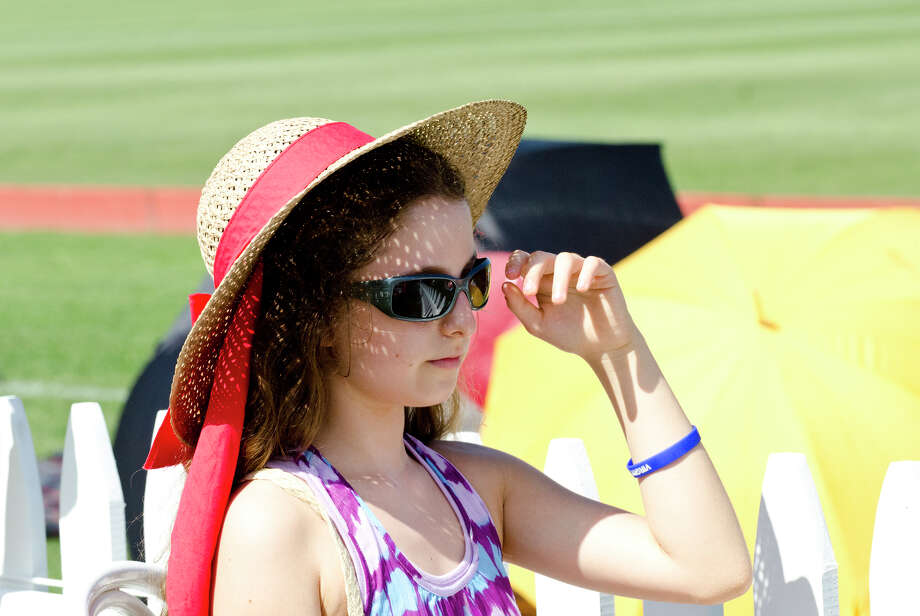 Helena Merker, 11, of Fort Lee, New Jersey, during the first annual Virginia House of Hope charity polo match fundraiser at the Greenwich Polo Club at Conyers Farm on Hurlingham Drive in Greenwich on Sunday, July 14, 2013. Photo: Amy Mortensen / Connecticut Post Freelance
