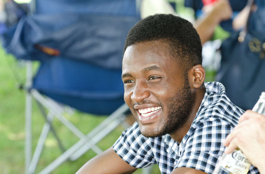 Xavier Andrews, of Brooklyn, smiles as he catches up with Princeton alumni during the first annual Virginia House of Hope charity polo match fundraiser at the Greenwich Polo Club at Conyers Farm on Hurlingham Drive in Greenwich on Sunday, July 14, 2013. Photo: Amy Mortensen / Connecticut Post Freelance