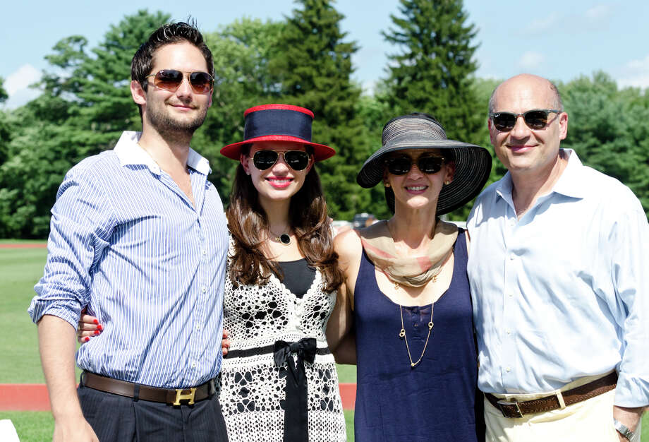 Harry Papathomas, of New Jersey; Cassandra Skoufalos, of Old Greenwich, Agatha Skoufalos, of Old Greenwich, and Stephan Skoufalos, of Old Greenwich, pose for a photo during the first annual Virginia House of Hope charity polo match fundraiser at the Greenwich Polo Club at Conyers Farm on Hurlingham Drive in Greenwich on Sunday, July 14, 2013. Photo: Amy Mortensen / Connecticut Post Freelance