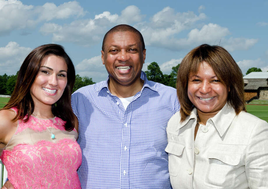 The Virginia House of Hope team from left, Sophia Gangei, Executive Director; Antonio Litman, Founder; Savine Poisson, Event Producer; pose for a photo during the first annual Virginia House of Hope charity polo match fundraiser at the Greenwich Polo Club at Conyers Farm on Hurlingham Drive in Greenwich on Sunday, July 14, 2013. Photo: Amy Mortensen / Connecticut Post Freelance