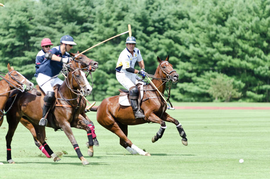 Heathcote's #3 Nicolas Manifold, at right, during the first annual Virginia House of Hope charity polo match fundraiser at the Greenwich Polo Club at Conyers Farm on Hurlingham Drive in Greenwich on Sunday, July 14, 2013. Photo: Amy Mortensen / Connecticut Post Freelance