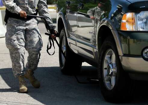 A vehicle is inspected before nearing the Lawrence H. WIlliams Judicial Center as a pretrial hearing gets underway, Tuesday, July 9, 2013, in Fort Hood, Texas. Jury selection is set to start Tuesday in the long-awaited murder trial of Army psychiatrist Maj. Nidal Hasan, accused of opening fire with a semi-automatic gun at Fort Hood nearly four years ago. (AP Photo/Tony Gutierrez) Photo: Tony Gutierrez, Associated Press / AP