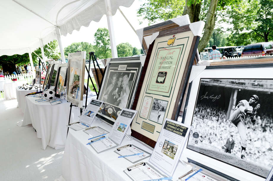 Items are placed up for auction during the first annual Virginia House of Hope charity polo match fundraiser at the Greenwich Polo Club at Conyers Farm on Hurlingham Drive in Greenwich on Sunday, July 14, 2013. Photo: Amy Mortensen / Connecticut Post Freelance