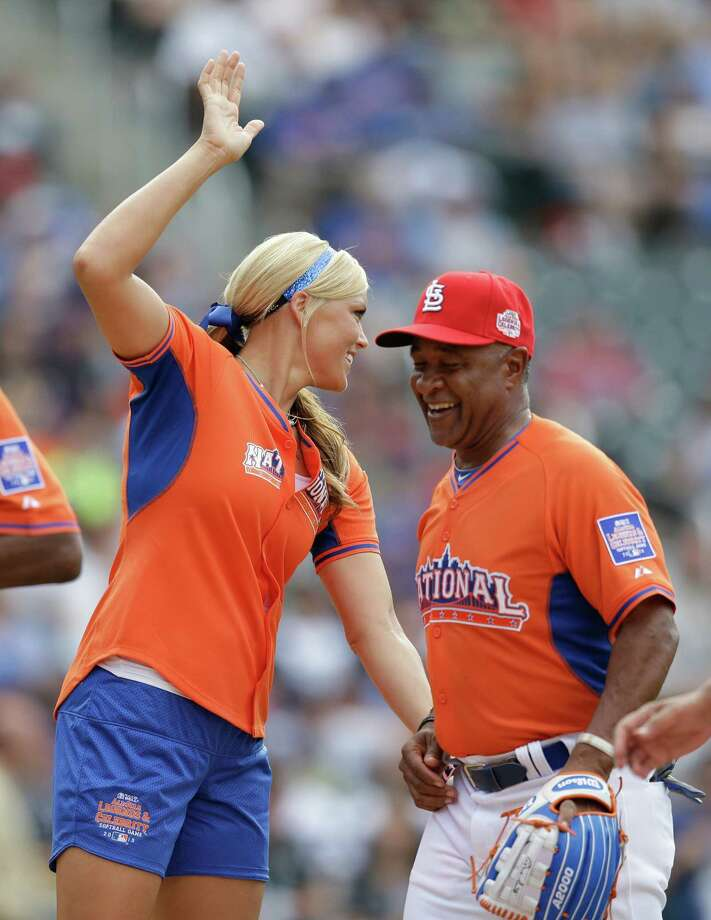 Former softball player Jennie Finch greets National League teammates with Ozzie Smith at the  All Star Legends & Celebrity Softball Game on Sunday, July 14, 2013 in New York. (AP Photo/Kathy Willens) Photo: Kathy Willens, Associated Press / AP