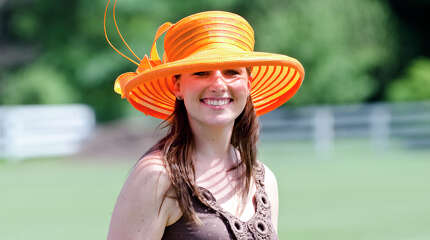 April Schrek, of Greenwich, smiles during the first annual Virginia House of Hope charity polo match fundraiser at the Greenwich Polo Club at Conyers Farm on Hurlingham Drive in Greenwich on Sunday, July 14, 2013.