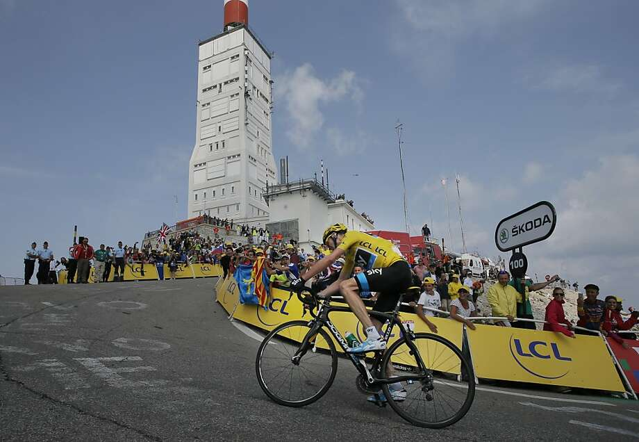Stage winner Christopher Froome of Britain, wearing the overall leader's yellow jersey,  climbs in the last 100 meters of the Mont Ventoux pass during the fifteenth stage of the Tour de France cycling race over 242.5 kilometers (150.7 miles) with start in in Givors and finish on the summit of Mont Ventoux pass, France, Sunday July 14, 2013. The riders climbed to an altitude of 1912 meters (6,273 Feet) tackling Mont Ventoux pass at the end of the longest stage of the 100th Tour de France edition. (AP Photo/Laurent Rebours) Photo: Laurent Rebours, Associated Press