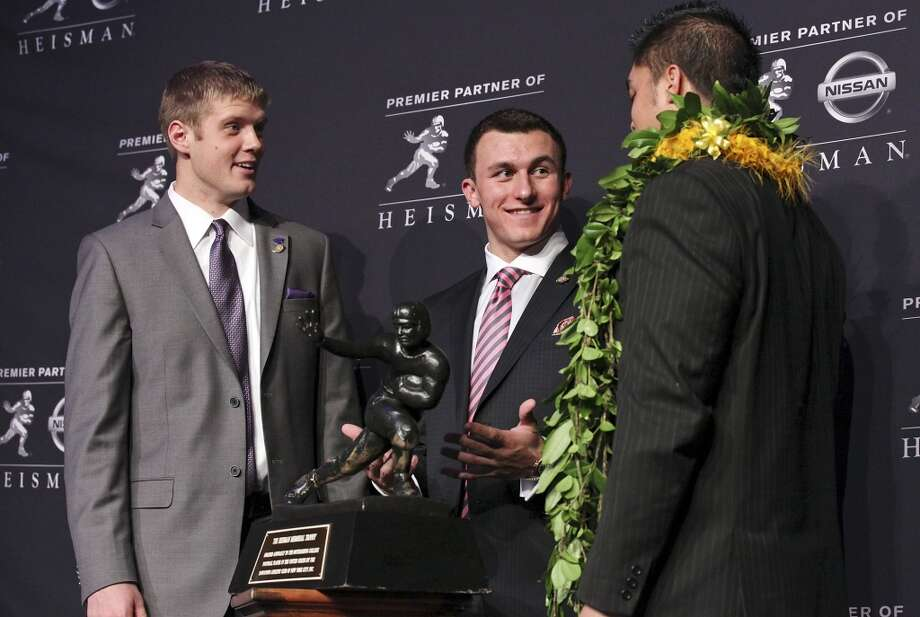 Heisman finalists Kansas State's quarterback Collin Klein (from left), Texas A&M's quarterback Johnny Manziel, and Notre Dame's linebacker Manti Te'o pose for photos during a press conference before the Heisman winner announcement Saturday Dec. 8, 2012 at the New York Marriott Marquis hotel in New York, New York. Photo: Edward A. Ornelas, San Antonio Express-News