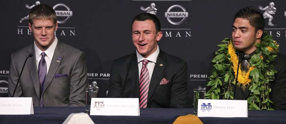 Heisman finalists Kansas State's quarterback Collin Klein (from left), Texas A&M's quarterback Johnny Manziel, and Notre Dame's linebacker Manti Te'o answer questions from the media during a press conference before the Heisman winner announcement Saturday Dec. 8, 2012 at the New York Marriott Marquis hotel in New York, New York. Photo: Edward A. Ornelas, San Antonio Express-News