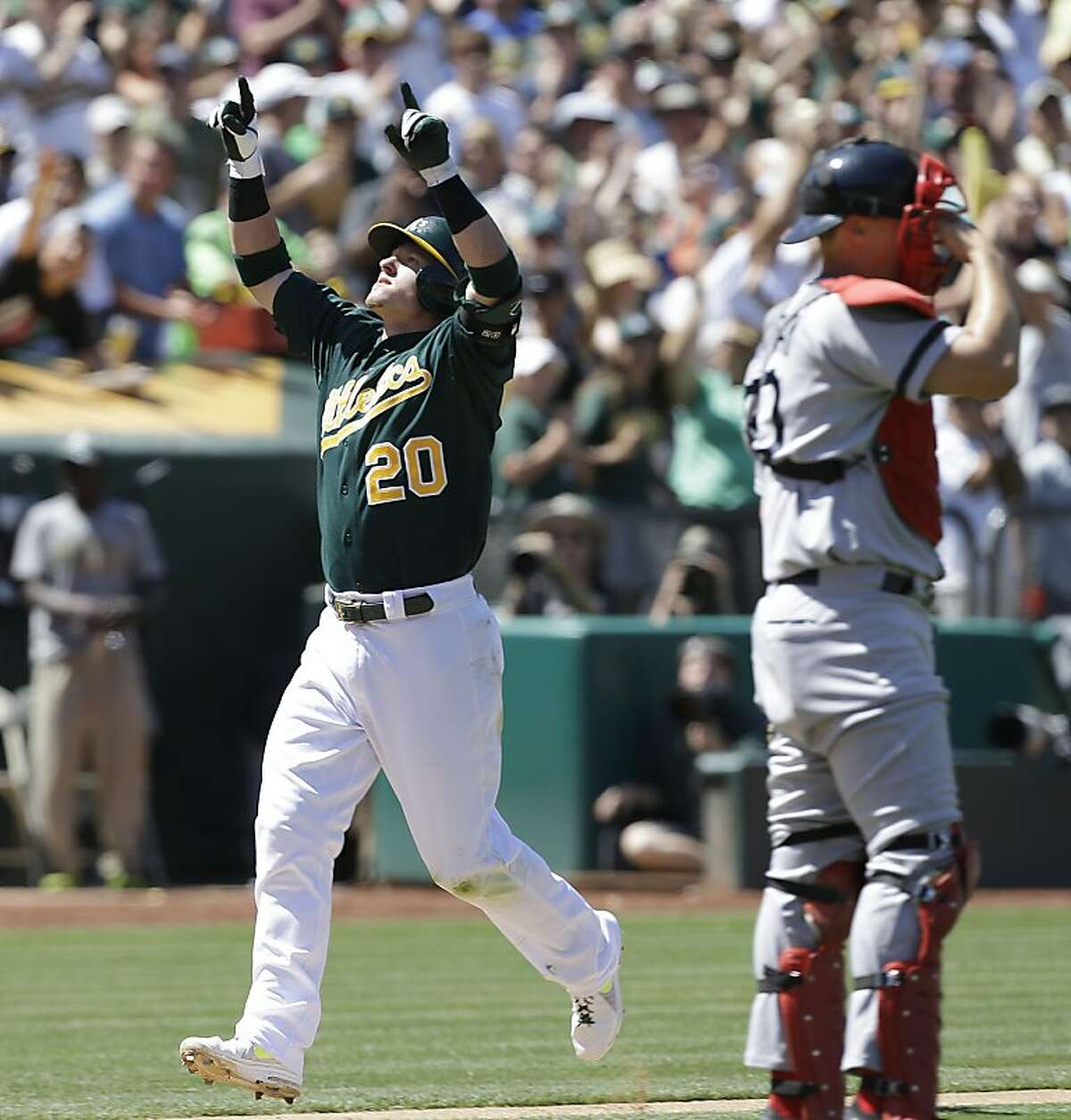 Oakland Athletics' Josh Donaldson (20) celebrates after hitting a two-run home run off Boston Red Sox's Brandon Workman in the seventh inning of a baseball game Sunday, July 14, 2013, in Oakland, Calif. (AP Photo/Ben Margot)