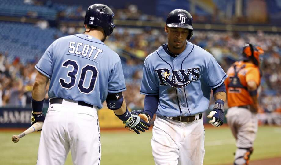 Desmond Jennings is congratulated by Luke Scott after scoring a run.