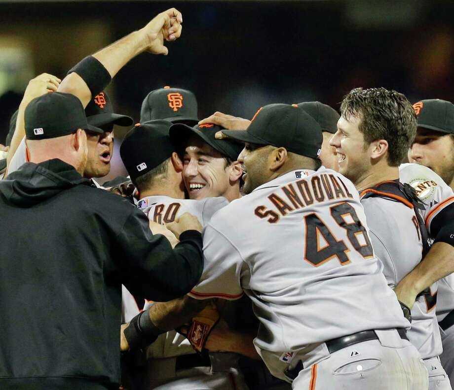 Tim Lincecum naturally is the center of attention after completing his no-hitter Saturday night. Photo: Lenny Ignelzi, STF / AP