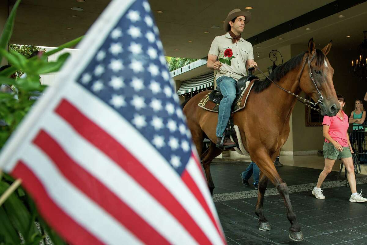 Alan Wakim rides on horseback as he prepares to pop the question to Jennifer Ann Molleda at the Hotel ZaZa on Sunday, July 14, 2013, in Houston.