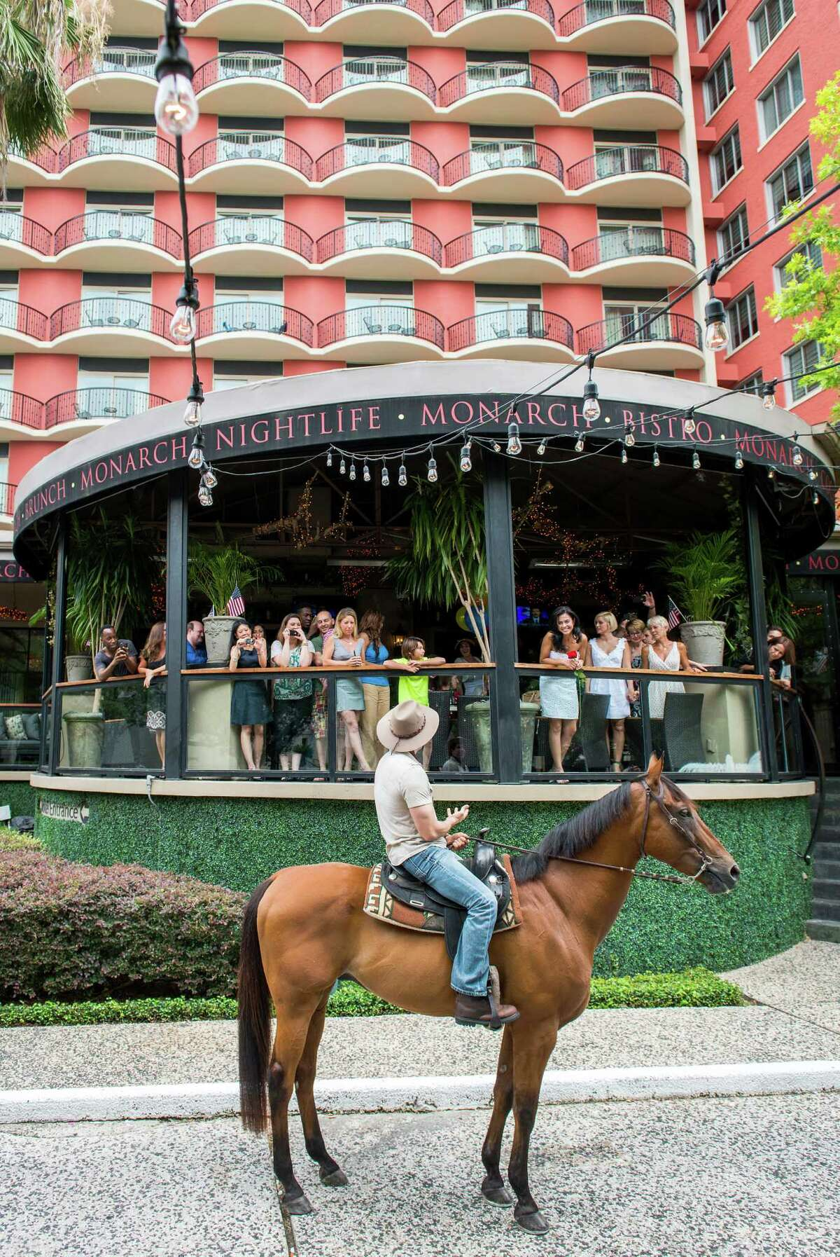 Alan Wakim interrupts his own birthday party at the Hotal ZaZa's Monarch restaurant to ride up on horseback and propose marriage to his girlfriend Jennifer Ann Molleda, seen on the balcony wearing white and holding a rose. Wakim excused himself from the party to return atop the horse named