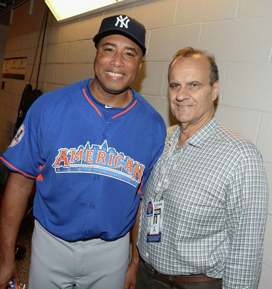 Bernie Williams and Joe Torre attend the 2013 Taco Bell All-Star Legends & Celebrity Softball Game at Citi Field on July 14, 2013 in the Queens borough of New York City. Photo: Theo Wargo, WireImage / Getty Images