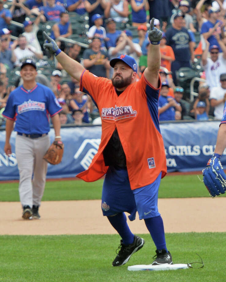 Actor/comedian Kevin James celebrates after sliding into second base at the Taco Bell All-Star Legends & Celebrity Softball Game at Citi Field on July 14, 2013 in New York City. Photo: Mike Coppola, Getty Images / Getty Images