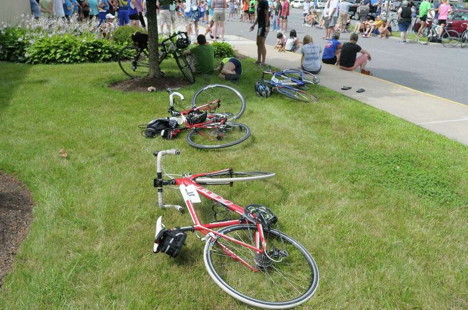 Racer's bikes are seen on the grass as they gather for the awards ceremony following the finish of the Pinebush Triathlon at the YMCA on Sunday, July 14, 2013 in Guilderland, NY.  (Paul Buckowski / Times Union) Photo: Paul Buckowski / 00023151A