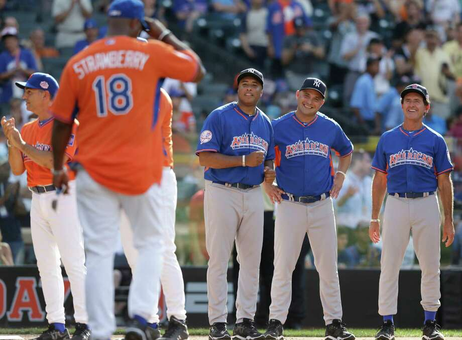 Former New York Mets outfielder Darryl Strawberry (18), representing the National League, tips his cap as Fred Lynn, right, Craig Carton, second from right, and Bernie Williams watch at the All Star Legends & Celebrity Softball Game, Sunday, July 14, 2013, in New York. John Franco, far left, looks on. Photo: AP