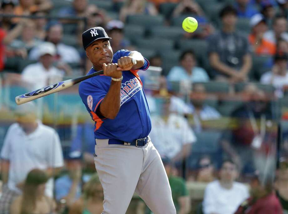 Former New York Yankees outfielder Bernie Williams swings at a pitch in the All Star Legends & Celebrity Softball Game on Sunday, July 14, 2013 in New York. Photo: AP