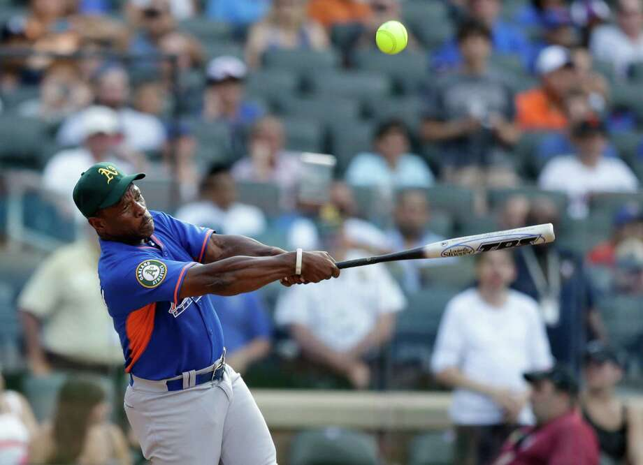 Former Oakland Athletics player Ricky Henderson swings at a pitch during the All Star Legends & Celebrity Softball Game on Sunday, July 14, 2013 in New York. Photo: AP