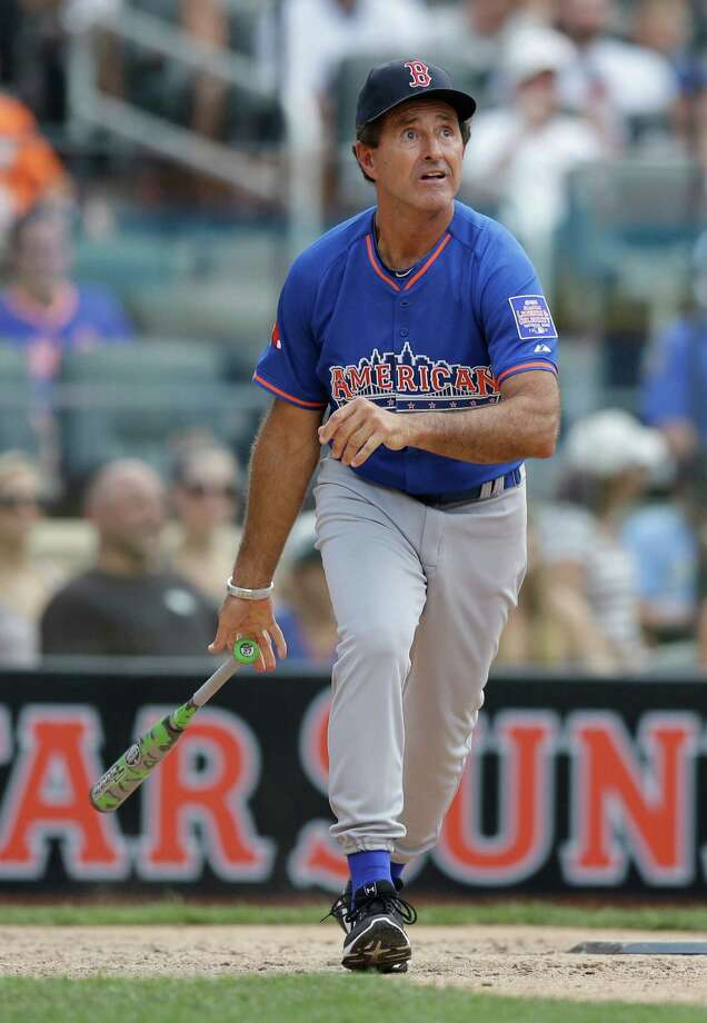 Former Boston Red Sox player Fred Lynn watches his hit during the All Star Legends & Celebrity Softball Game on Sunday, July 14, 2013 in New York. Photo: AP
