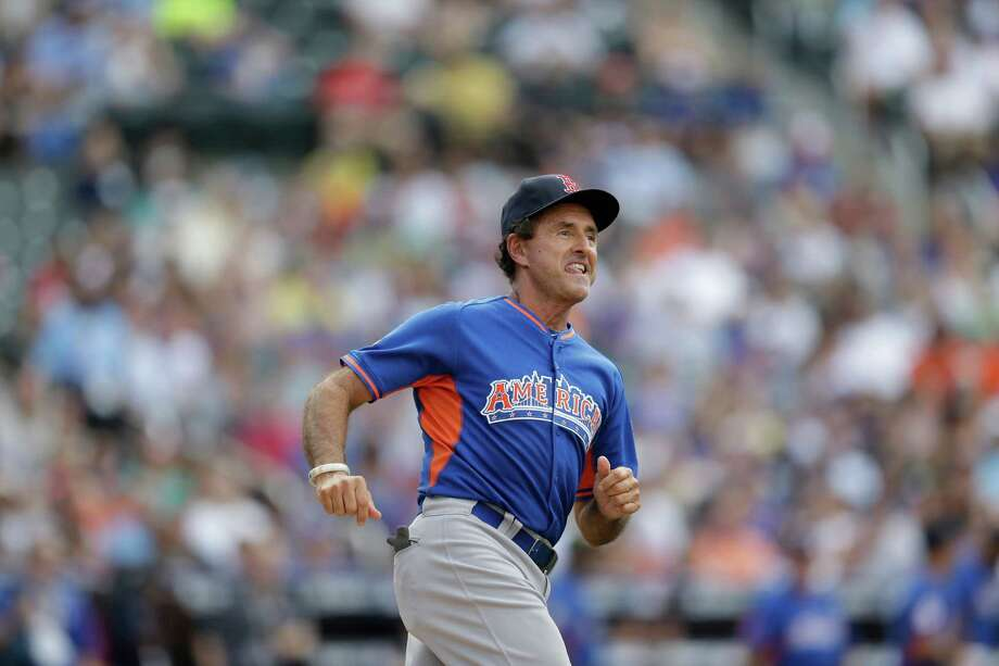 Former Boston Red Sox player Fred Lynn runs the bases during the All Star Legends & Celebrity Softball Game on Sunday, July 14, 2013 in New York. Photo: AP