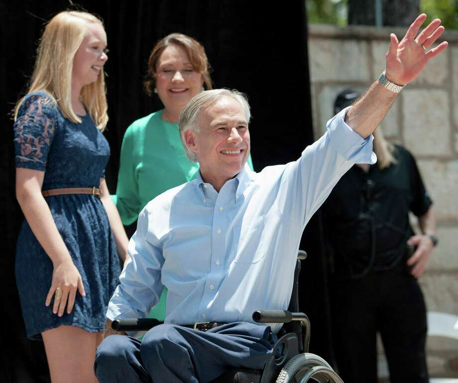Texas Attorney General Greg Abbott waves to supporters as he takes the stage during an event to announce his 2014 campaign for governor, Sunday, July 14, 2013, in San Antonio.Already well-known in political circles and extremely well-financed, Attorney General Greg Abbott launched his gubernatorial campaign Sunday, hoping to seize the fiercely socially conservative mantle of Gov. Rick Perry that has helped make Texas the country's largest red state. Photo: Darren Abate, Associated Press / FR115 AP