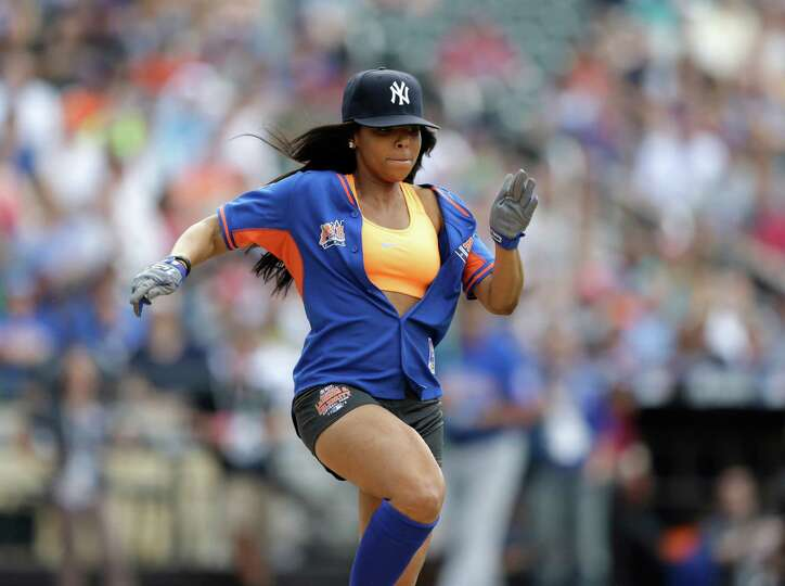 Singer Ashanti runs the base path during the All Star Legends & Celebrity Softball Game on Su