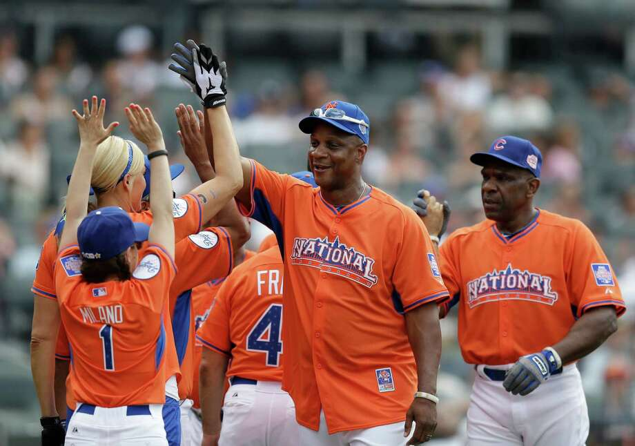 Former New York Mets outfielder Darryl Strawberry greets National League teammates at the All Star Legends & Celebrity Softball Game on Sunday, July 14, 2013 in New York. Photo: AP