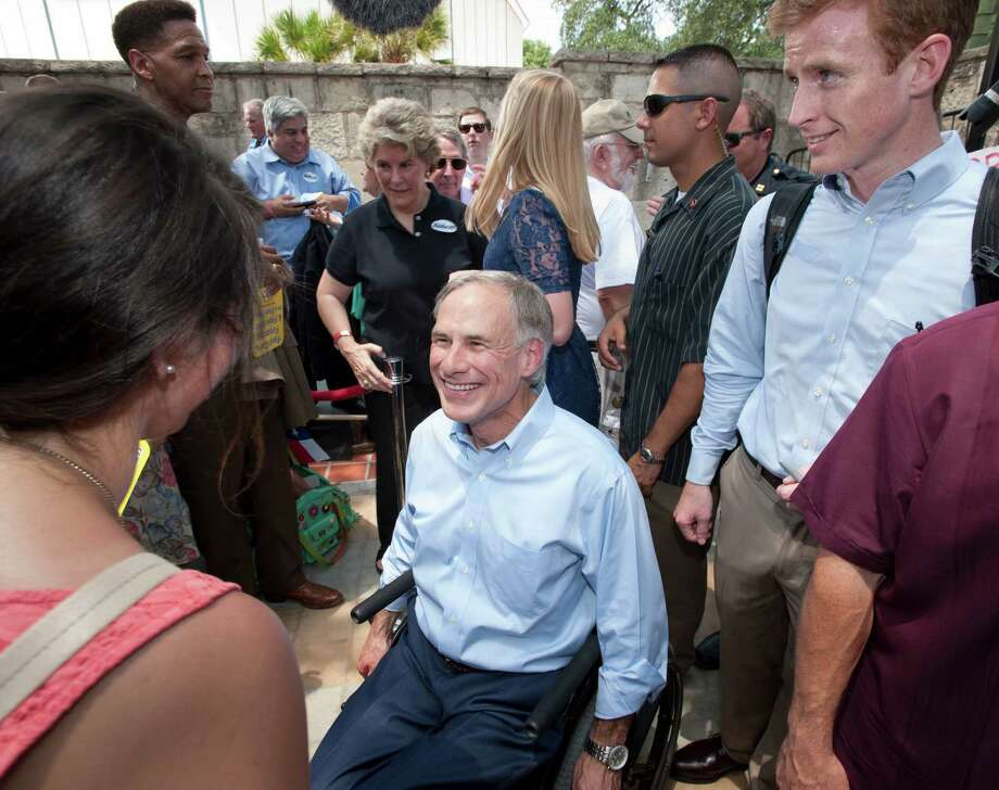 Texas Attorney General Greg Abbott, center, speaks with supporters during an event to announce his 2014 campaign for governor, Sunday, July 14, 2013, in San Antonio. Already well-known in political circles and extremely well-financed, Attorney General Greg Abbott launched his gubernatorial campaign Sunday, hoping to seize the fiercely socially conservative mantle of Gov. Rick Perry that has helped make Texas the country's largest red state. Photo: Darren Abate, Associated Press / FR115 AP