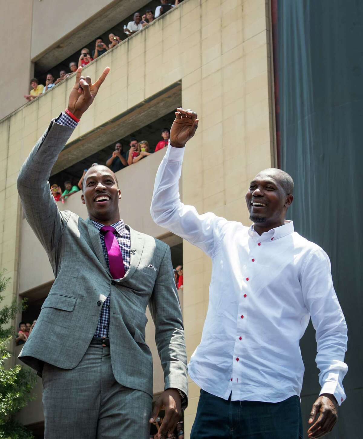 In happier times, Dwight Howard (left) was joined by Rockets legend Hakeem Olajuwon after the former signed with the team in 2013. Click through the gallery to relive Howard's time in Houston.