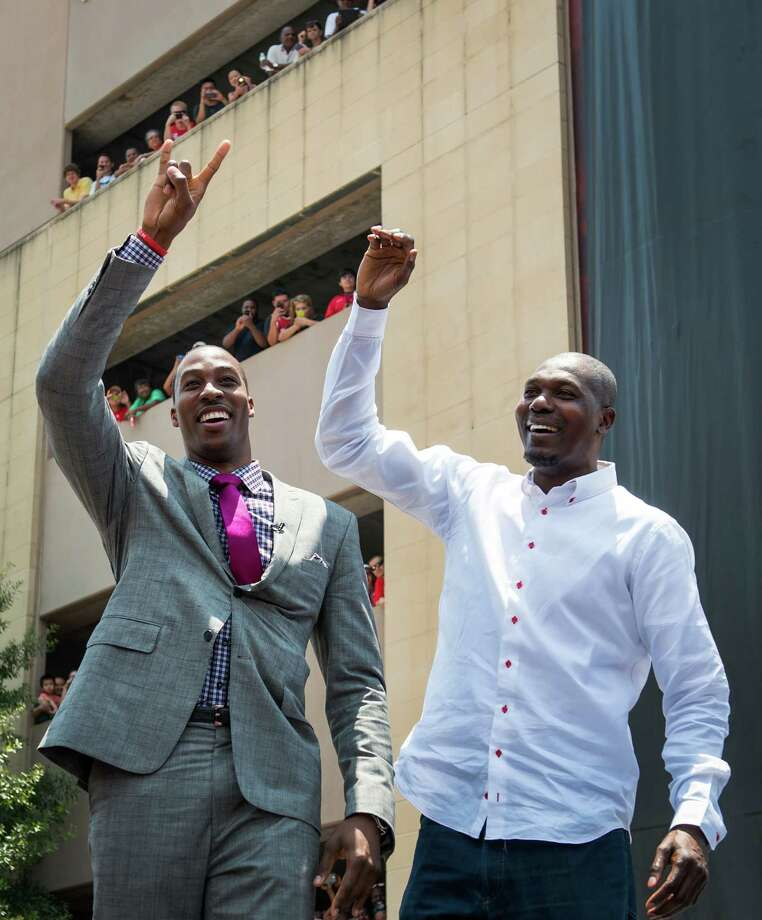 In happier times, Dwight Howard (left) was joined by Rockets legend Hakeem Olajuwon after the former signed with the team in 2013.Click through the gallery to relive Howard's time in Houston. Photo: Smiley N. Pool, MBO / Houston Chronicle