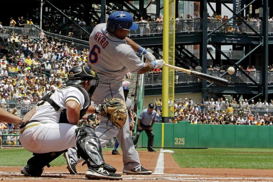 New York Mets' Marlon Byrd (6) drives in Eric Young Jr. with a double off Pittsburgh Pirates starting pitcher Gerrit Cole during the first inning of a baseball game in Pittsburgh Sunday, July 14, 2013. The Mets won 4-2. (AP Photo/Gene J. Puskar) ORG XMIT: PAGP106 Photo: Gene J. Puskar / AP