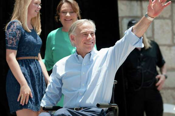 Texas Attorney General Greg Abbott waves to supporters from the stage Sunday to announce his 2014 campaign for governor.