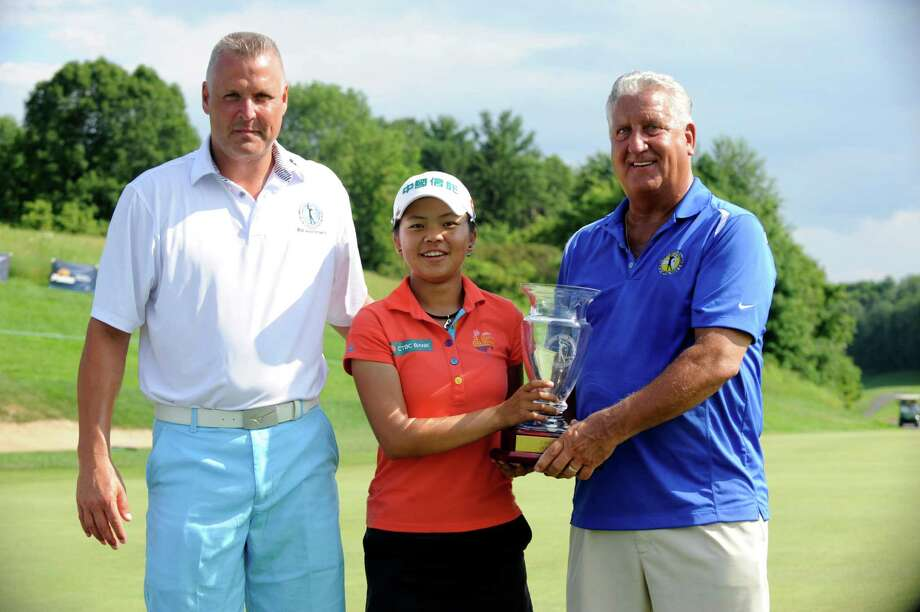 Tournament Director Jimmy Miller,left, and Albany Mayor Gerald Jennings ,right, present Wei-Ling Hsu with the tournamnet trophy after winning the Credit Union Challenge on the Symetra Tour stop held at Capital Hills golf course in Albany, N.Y., Sunday, July 14, 2013. (Hans Pennink / Special to the Times Union) ORG XMIT: HP109 Photo: Hans Pennink / Hans Pennink