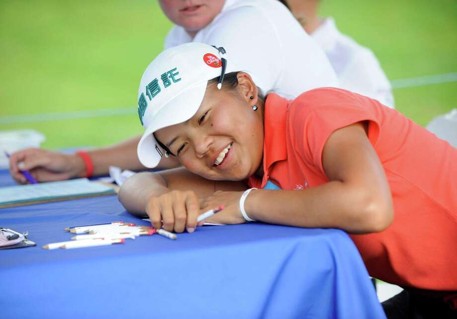 Wei-Ling Hsu  reacts while signing her score card after winning the final round of the Credit Union Challenge on the Symetra Tour stop held at Capital Hills golf course in Albany, N.Y., Sunday, July 14, 2013. (Hans Pennink / Special to the Times Union) ORG XMIT: HP106 Photo: Hans Pennink / Hans Pennink