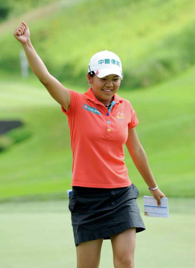Wei-Ling Hsu waves to the crowd on the 18th hole after winning the final round of the Credit Union Challenge on the Symetra Tour stop held at Capital Hills golf course in Albany, N.Y., Sunday, July 14, 2013. (Hans Pennink / Special to the Times Union) ORG XMIT: HP103 Photo: Hans Pennink / Hans Pennink