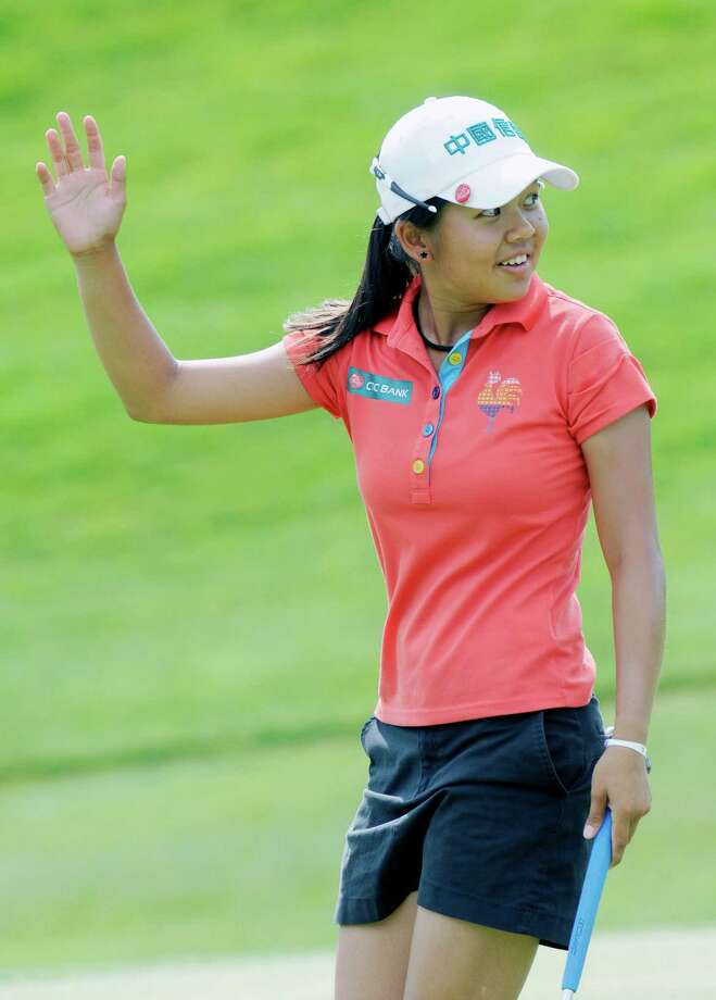 Wei-Ling Hsu waves to the crowd on the 18th hole after winning the final round of the Credit Union Challenge on the Symetra Tour stop held at Capital Hills golf course in Albany, N.Y., Sunday, July 14, 2013. (Hans Pennink / Special to the Times Union) ORG XMIT: HP102 Photo: Hans Pennink / Hans Pennink