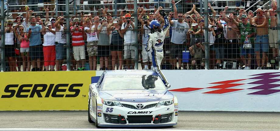 LOUDON, NH - JULY 14:  Brian Vickers, driver of the #55 Aaron's Dream Machine Toyota, celebrates winning the NASCAR Sprint Cup Series Camping World RV Sales 301 at New Hampshire Motor Speedway on July 14, 2013 in Loudon, New Hampshire.  (Photo by Jerry Markland/Getty Images) ORG XMIT: 159334317 Photo: Jerry Markland / 2013 Getty Images