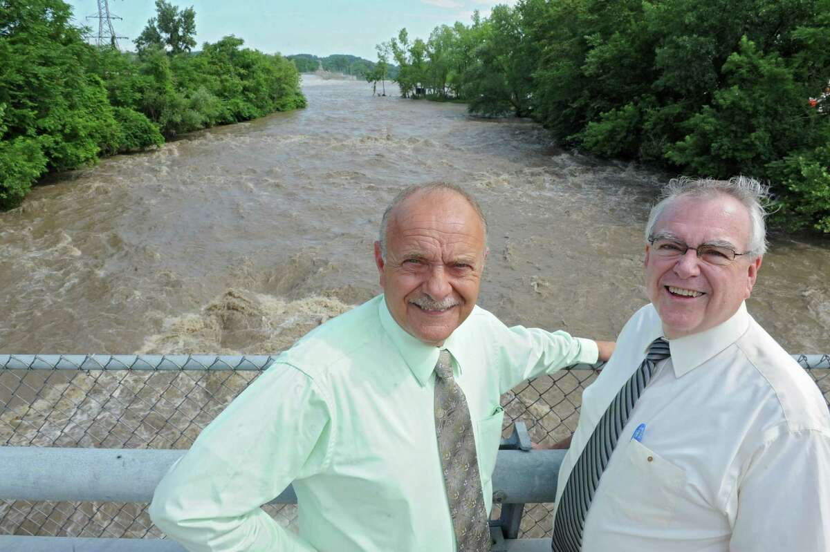 Cohoes Mayor George Primeau, left, and Ed Tremblay, director of community and economic development, stand on the bridge at Simmons Island overlooking rapids which are part of a planned kayaking route on Wednesday, July 3, 2013, in Cohoes, N.Y. (Lori Van Buren / Times Union)