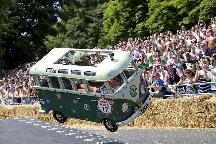 "Follow the bouncing bus:A ""hippie Volkswagen Bus"" goes airborne over an obstacle in the Red Bull Soapbox race in London. Photo: Justin Tallis, AFP/Getty Images"