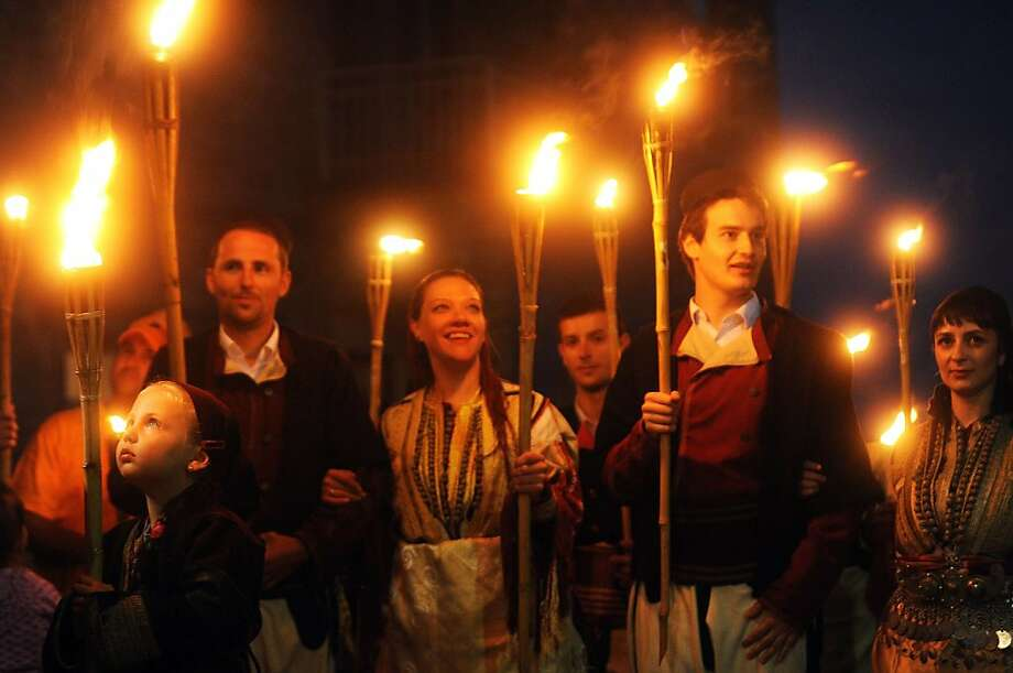 Young men and women with torches participate late on July 13, 2013 in a wedding procession a night before a wedding ceremony in the western Macedonian village of Galicnik, some 150 km southwest of Skopje. Every year, around the Christian Orthodox holiday of Petrovden (St. Peter'ss day), Macedonians from Galicnik gather in the near-deserted mountain village and a couple gets married according to the old traditions of the region. AFP PHOTO/ROBERT ATANASOVSKIROBERT ATANASOVSKI/AFP/Getty Images Photo: Robert Atanasovski, AFP/Getty Images