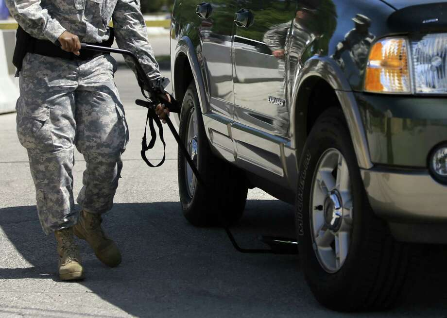 A vehicle is inspected at Fort Hood, where jury selection in the Nadal Hasan trial continues this week amid tight security. Photo: Tony Gutierrez / Associated Press