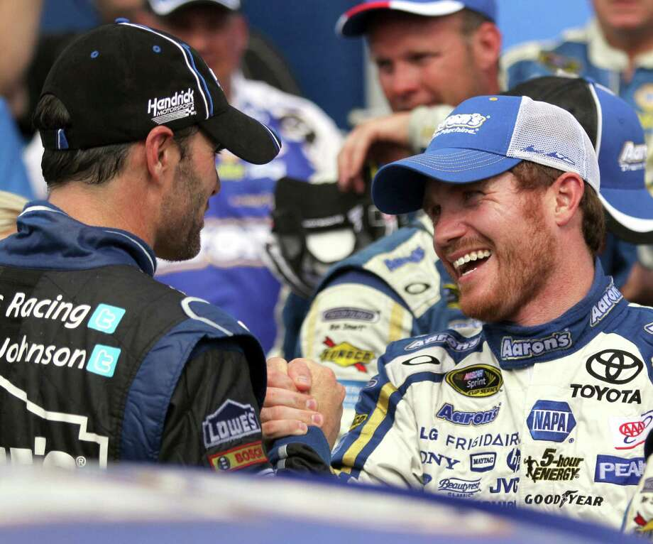 Brian Vickers' first victory since 2009 pleased fellow drivers like Jimmie Johnson, left, because of the health problems Vickers endured in recent years. Photo: Mary Schwalm, FRE / FR158029 AP