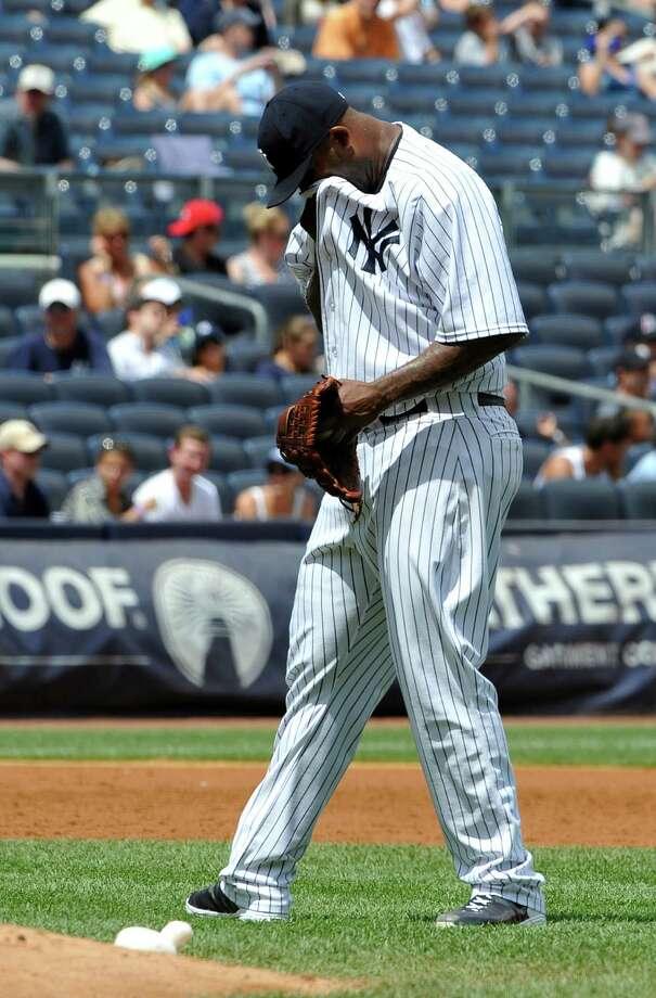 CC Sabathia struggles to shake off a three-run homer by Aaron Hicks. Photo: Kathy Kmonicek, FRE / FR170189 AP
