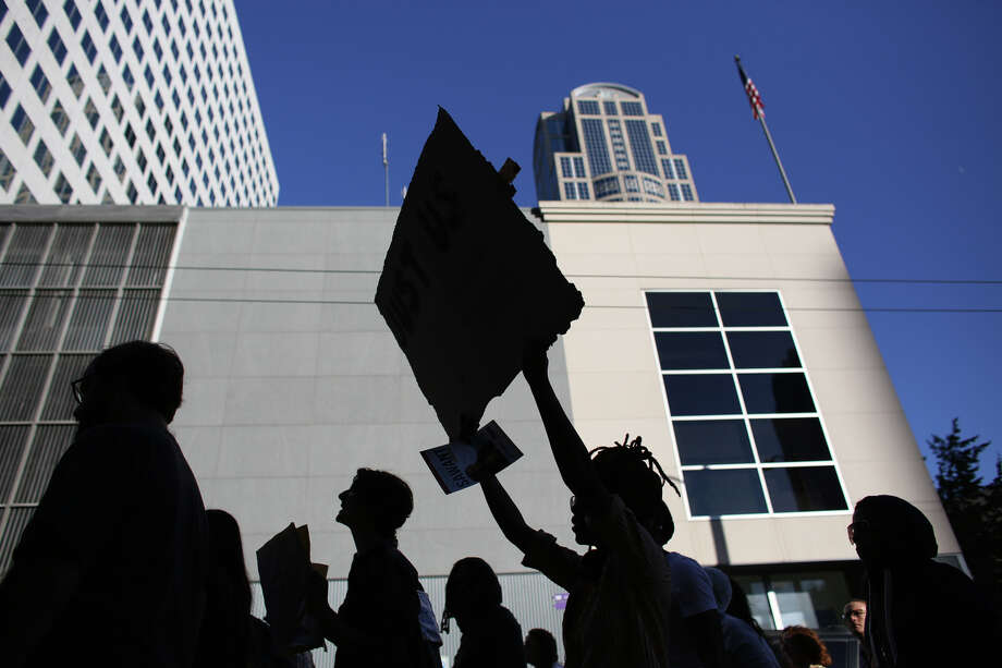 People march through downtown Seattle to protest the acquittal of George Zimmerman, the Florida man accused of shooting and killing Trayvon Martin. Photo: JOSHUA TRUJILLO, SEATTLEPI.COM