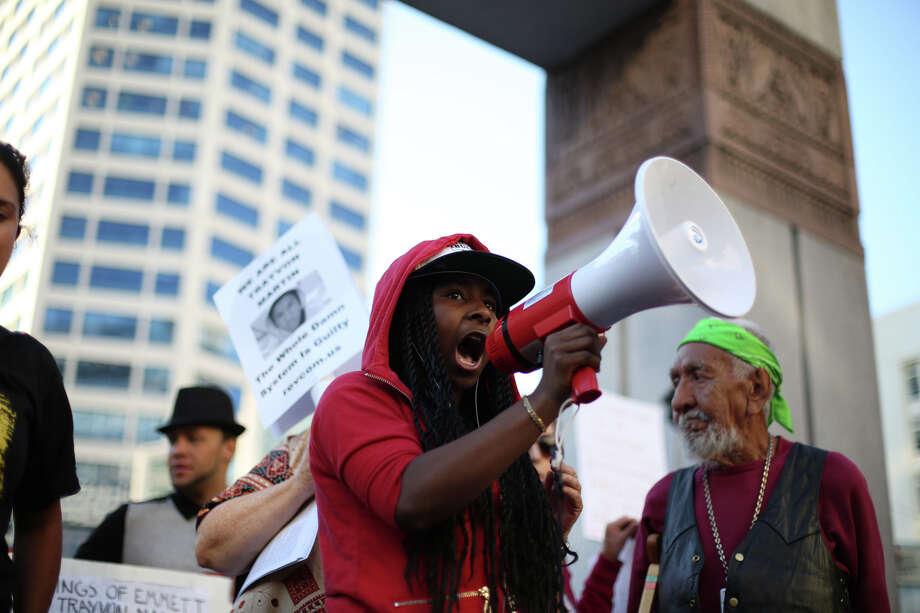 A speaker addresses the crowd at Westlake Park. Photo: JOSHUA TRUJILLO, SEATTLEPI.COM