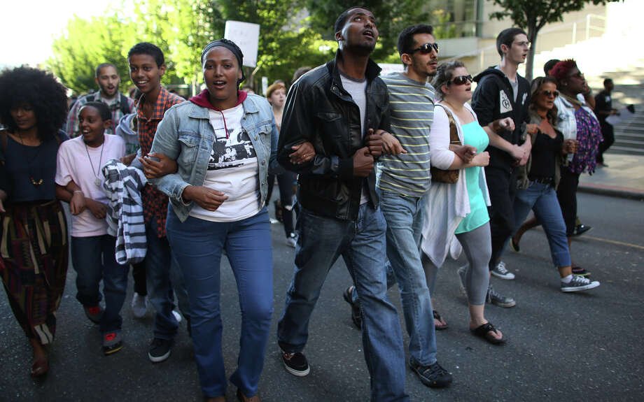 People march outside the Federal Courthouse to protest the acquittal of George Zimmerman, the Florida man accused of shooting and killing Trayvon Martin. Photo: JOSHUA TRUJILLO, SEATTLEPI.COM