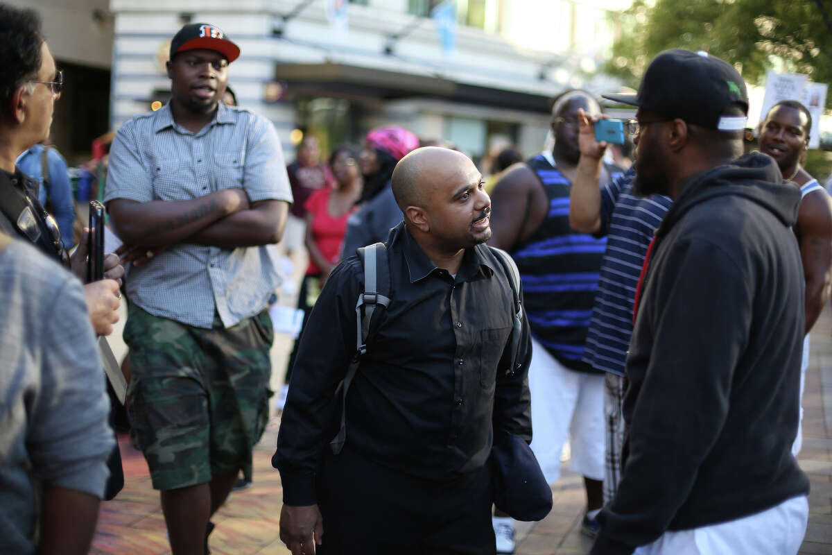 J. Boswell, center, confronts other protesters, asking how they could make this a black and white issue. Boswell, who said he is of mixed race, said he has experienced racial issues from multiple perspectives. Boswell was involved in a few brief shouting matches with protesters during the rally.