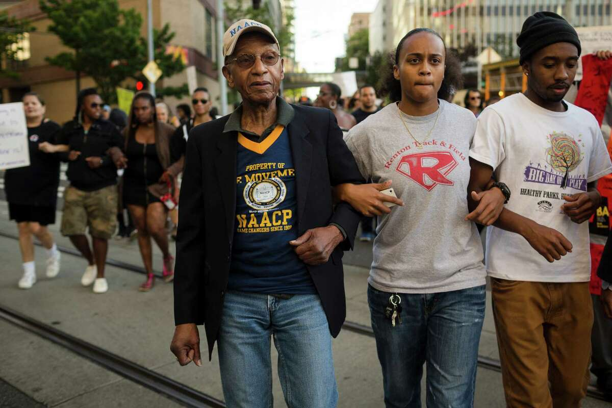 Oscar Eason Jr., center, joins Trayvon Martin supporters during a protest over the George Zimmerman verdict.